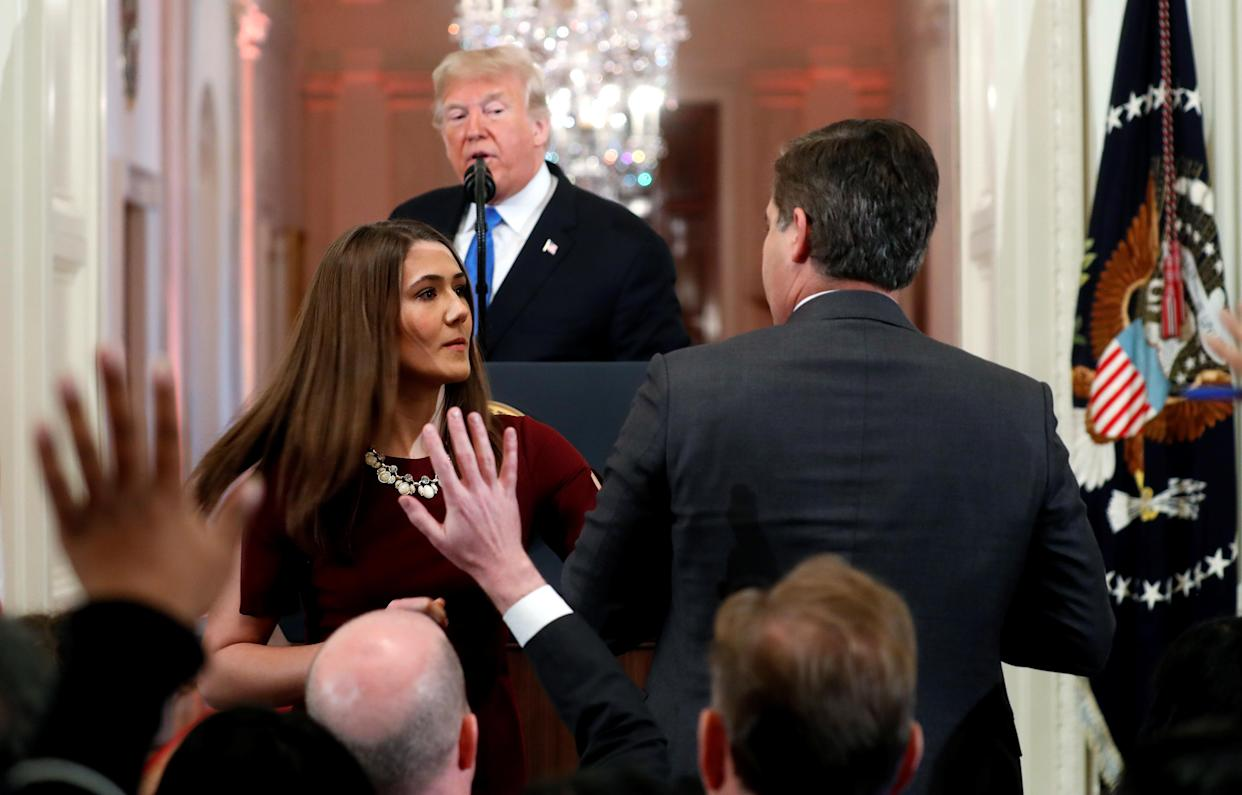 A White House staff member steps in to try to take the microphone away from CNN's Jim Acosta as he questions U.S. President Donald Trump during a news conference following Tuesday's midterm U.S. congressional elections at the White House in Washington, Nov. 7, 2018. (Photo: Kevin Lamarque/Reuters)