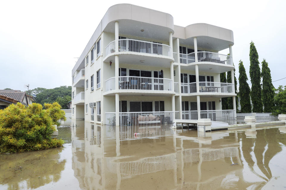 Townsville flooding: Entire levels of an apartment complex sit under the surface of the flood water. Source: AFP