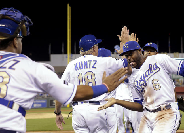 <p>Kansas City Royals' Salvador Perez, left, and Lorenzo Cain (6) celebrate after the team's baseball game against the Baltimore Orioles on May 12, 2017, in Kansas City, Mo. The Royals won 3-2. (Photo: Charlie Riedel/AP) </p>