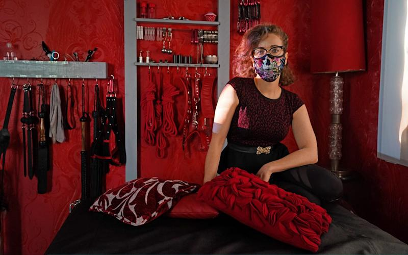 BERLIN, GERMANY - JULY 06: Kat Rix, a sex worker at the Studio Lux domina BDSM sex studio, poses for a photo in her work room during the novel coronavirus pandemic on July 06, 2020 in Berlin, Germany. Sex workers in Berlin are demanding an easing of ongoing lockdown measures that are preventing them from resuming their work. While authorities have lifted lockdown measures for most businesses in Germany, some, especially for those that involve close physical contact, remain in place. Legal sex workers claim they are being treated unfairly, claiming they have developed adequate hygienic measures to prevent the spread of the virus and point out that other businesses that require similar physical proximity, such as hair salons and tattoo parlors, have been allowed to reopen. (Photo by Sean Gallup/Getty Images) *** BESTPIX *** - Sean Gallup/Getty Images Europe