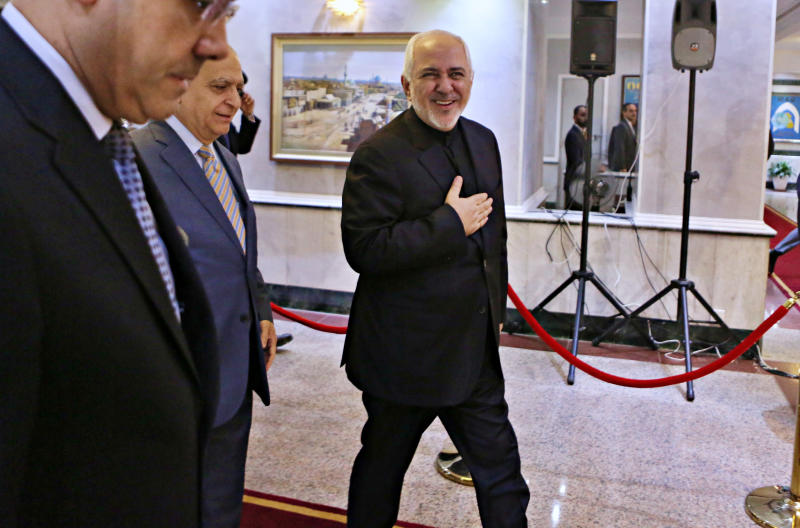 Iranian Foreign Minister Mohammad Javad Zarif, center, arrives at the Ministry of Foreign Affairs before his meeting with his Iraqi counterpart Mohamed Alhahkim in Baghdad, Iraq, Sunday, May 26, 2019. (AP Photo/Khalid Mohammed)