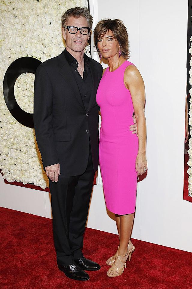 "BEVERLY HILLS, CA - FEBRUARY 23:  Actors Harry Hamlin and Lisa Rinna attend ""The Buzz On The Red Carpet""  presented by  QVC at Four Seasons Hotel Los Angeles at Beverly Hills on February 23, 2012 in Beverly Hills, California.  (Photo by Joe Kohen/Getty Images)"