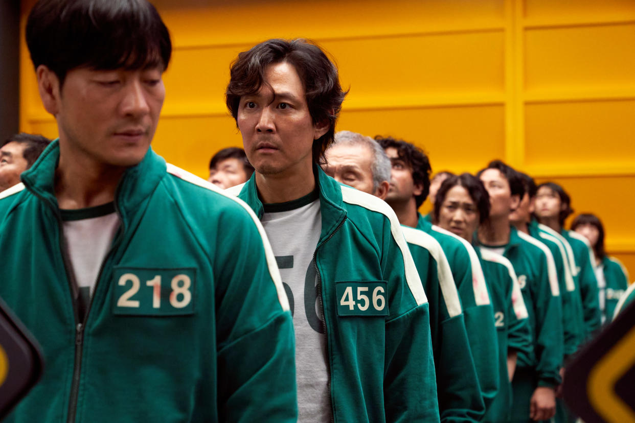 Lee Jung-jae (centre) stars in Squid Game (Netflix/Youngkyu Park/PA)