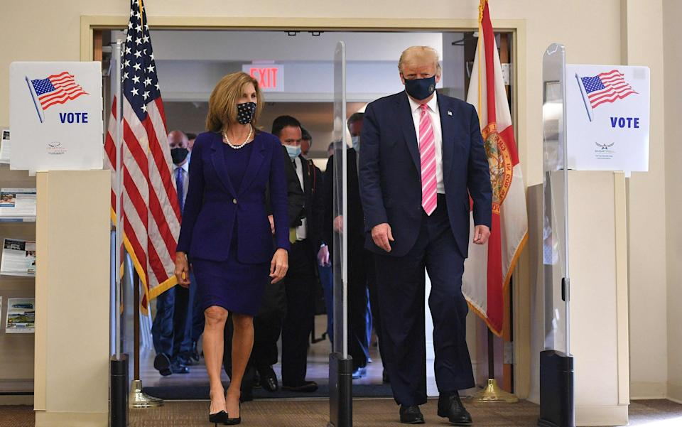 Donald Trump leaves the polling station after casting his ballot - AFP