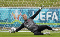 Denmark's goalkeeper Kasper Schmeichel exercises at the training ground during a training session of Denmark's national team in Helsingor, Denmark, Monday, June 14, 2021. It is the first training of the Danish team since the Euro championship soccer match against Finland when Christian Eriksen collapsed last Saturday. (AP Photo/Martin Meissner)