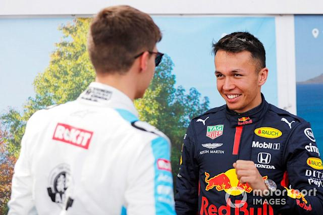 """George Russell, Williams Racing, con Alex Albon, Red Bull Racing <span class=""""copyright"""">Sam Bloxham / Motorsport Images</span>"""