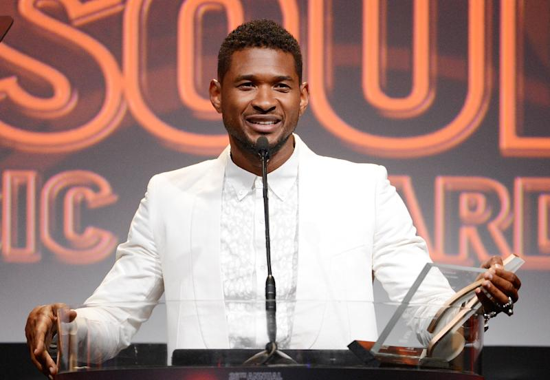 """FILE - In this June 27, 2013 file photo shows Usher accepts the golden note award at the 26th Annual ASCAP Rhythm & Soul Music Awards in Beverly Hills, Calif. Usher's ex-wife asked for an emergency custody hearing a day after one of the pair's sons nearly drowned in a pool at the singer's Atlanta home. A lawyer for Tameka Foster Raymond filed the request in Fulton County Superior Court on Tuesday, Aug. 6. The court filing says the boy """"suffered a near-death accident"""" while left unsupervised in a pool at the Grammy winner's home. A judge has set a hearing for Friday. (AP Photo/ASCAP, Phil McCarten, File)"""