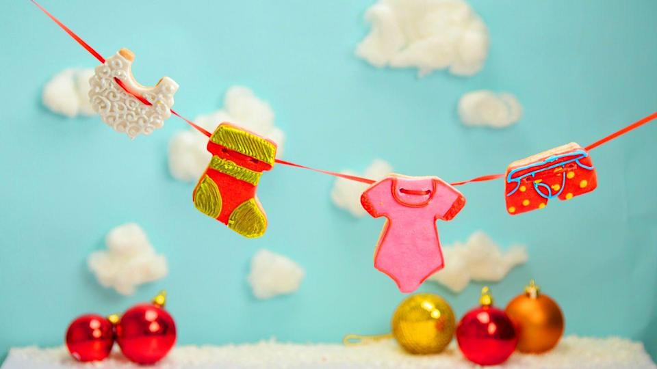 """<p>Even Santa can't escape the weekly wash! These washing line biscuits are a perfect Secret Santa gift or an alternative Christmas decoration for your home.</p><p><strong>Recipe: <a href=""""https://www.goodhousekeeping.com/uk/food/recipes/a29811450/santas-washing-line-biscuits/"""" rel=""""nofollow noopener"""" target=""""_blank"""" data-ylk=""""slk:Santa's Washing Line"""" class=""""link rapid-noclick-resp"""">Santa's Washing Line</a></strong></p>"""