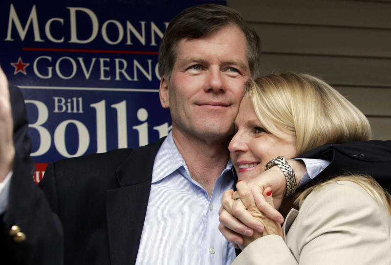 FILE- In this Oct. 31, 2009 file photo, Republican gubernatorial candidate Bob McDonnell, hugs his wife, Maureen, during a rally in Richmond, Va., McDonnell and his wife were indicted Tuesday, Jan. 21, 2014, on corruption charges after a monthslong federal investigation into gifts the Republican received from a political donor. (AP Photo/Steve Helber, File)
