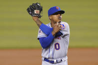 New York Mets starting pitcher Marcus Stroman stretches after giving up a single to Miami Marlins' Jazz Chisholm Jr. during the first inning of a baseball game Friday, May 21, 2021, in Miami. (AP Photo/Lynne Sladky)
