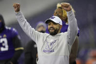 Washington head coach Jimmy Lake celebrates after Washington beat Oregon State 27-21 in an NCAA college football game, Saturday, Nov. 14, 2020, in Seattle. The game was Lake's first since he was named head coach. (AP Photo/Ted S. Warren)