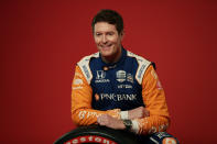 In this Feb. 10, 2020, photo, IndyCar driver Scott Dixon poses for photos during IndyCar Media Day Auto Racing in Austin, Texas. Dixon, Alexander Rossi and the rest of the IndyCar drivers were in sunny Florida around spring break ready to start the season. (AP Photo/Eric Gay)