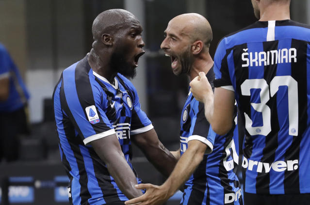 Inter Milan's Borja Valero, center, celebrates with his teammates Romelu Lukaku, left, and Milan Skriniar after scoring his side's third goal during the Serie A soccer match between Inter Milan and Sassuolo at the San Siro Stadium, in Milan, Italy, Wednesday, June 24, 2020. (AP Photo/Luca Bruno)
