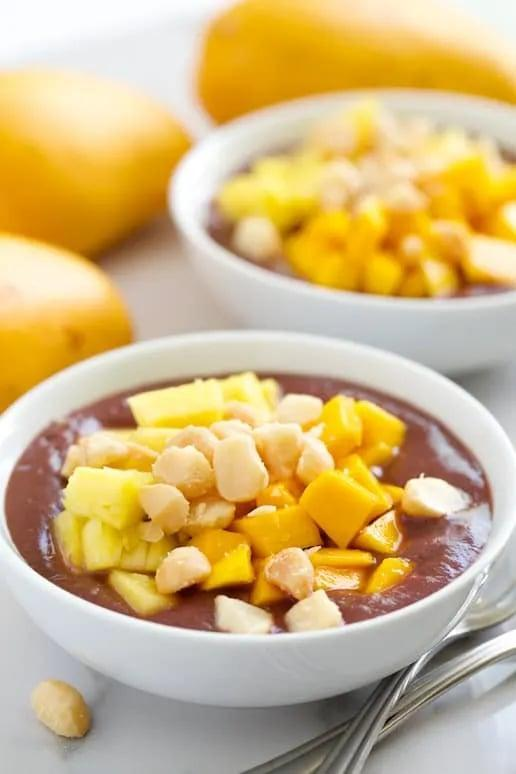 "<p>This tropical açai smoothie bowl will transport you straight to the islands with mango, pineapple, and macadamia nuts as toppings. The actual smoothie base only has three ingredients, making this recipe super easy. </p><p><strong>Get the recipe:</strong> <a href=""http://getinspiredeveryday.com/food/kauai-acai-smoothie-breakfast-bowls/?utm_source=rss&utm_medium=rss&utm_campaign=kauai-acai-smoothie-breakfast-bowls#tasty-recipes-14056"" class=""link rapid-noclick-resp"" rel=""nofollow noopener"" target=""_blank"" data-ylk=""slk:Kauai açai smoothie breakfast bowls from Get Inspired Everyday"">Kauai açai smoothie breakfast bowls from Get Inspired Everyday</a></p>"