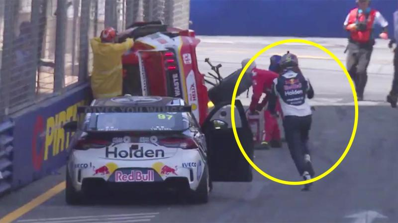 Shane van Gisbergen hops out of his car and runs to check on rival Scott McLaughlin after a horror crash.