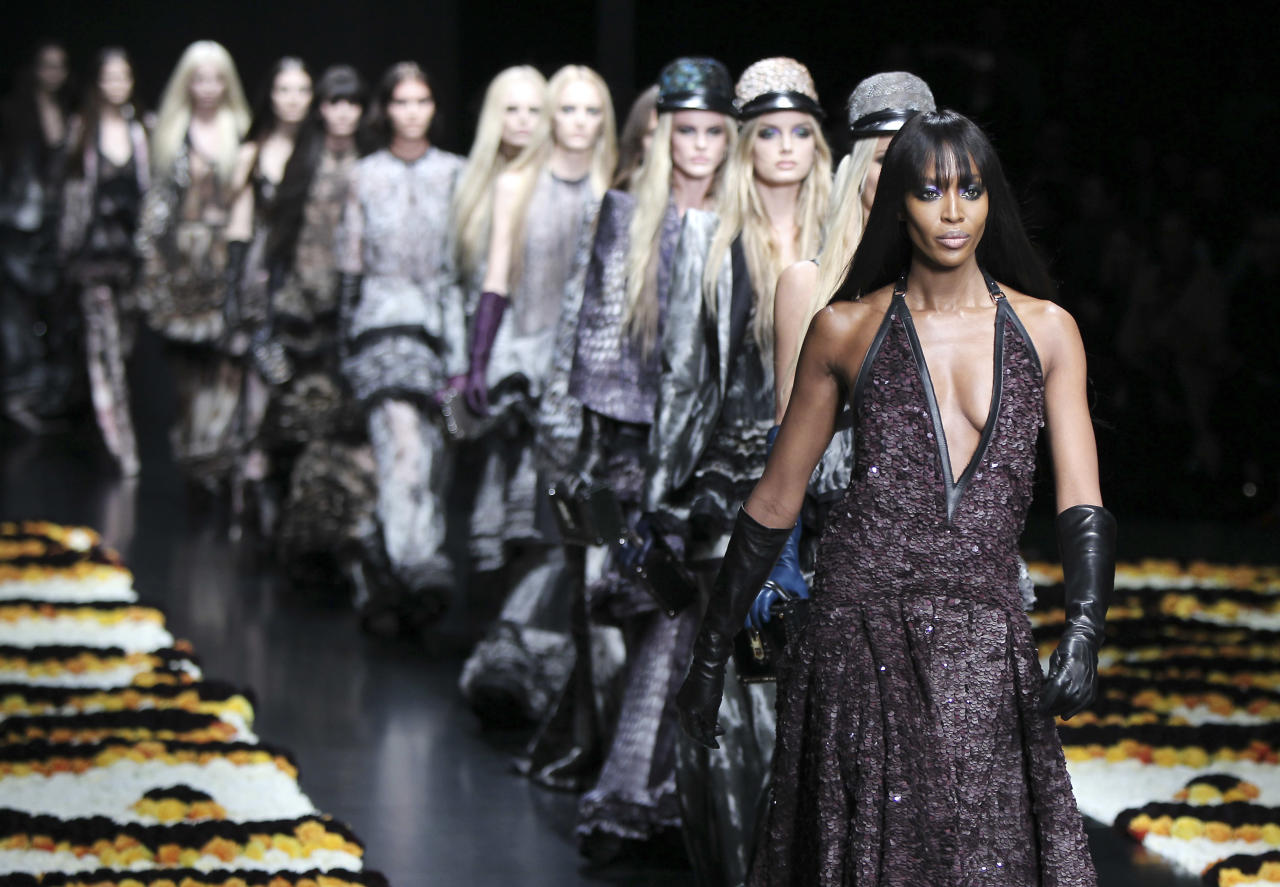 Britain top model Naomi Campbell, right, wears with others models creations part of the Roberto Cavalli women's Fall-Winter 2012-13 fashion collection, during the fashion week in Milan, Italy, Monday, Feb. 27, 2012. (AP Photo/Antonio Calanni)