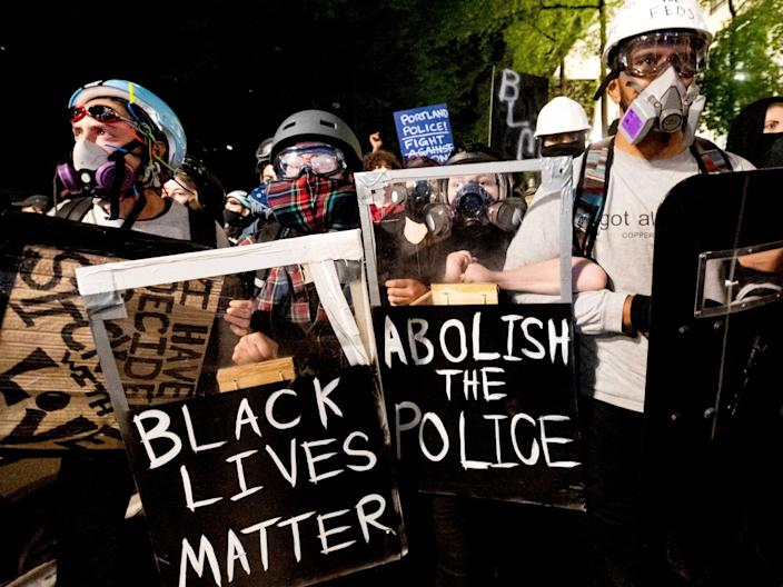 """Protesters march through Portland after rallying at the Mark O. Hatfield United States Courthouse on August 2, 2020. <p class=""""copyright"""">Noah Berger/AP</p>"""