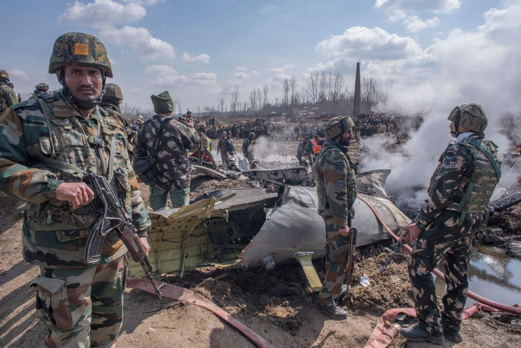 <p>Indian government and military forces attend to the scene of a crashed Indian Air Force aircraft on Feb. 27, 2019 in Budgam west of Srinagar, the summer capital of Indian administered Kashmir, India. The aircraft crashed in Budgam district, killing six people including two pilots and a civilian. Tensions have increased in the region after India claimed to have struck alleged militant camps inside Pakistani territory on Tuesday in response to a suicide bombing attack in Pulwama while Pakistan Wednesday claimed to have shot down two intruding Indian fighter jets and capturing two pilots. (Photo from Yawar Nazir/Getty Images) </p>