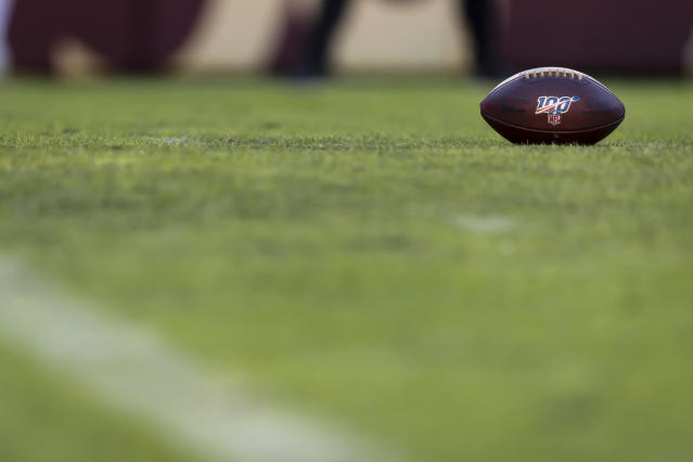 "LANDOVER, MD - DECEMBER 15: A Wilson brand NFL football with 100 logo is seen on the field during the first half of the game between the <a class=""link rapid-noclick-resp"" href=""/nfl/teams/washington/"" data-ylk=""slk:Washington Redskins"">Washington Redskins</a> and the <a class=""link rapid-noclick-resp"" href=""/nfl/teams/philadelphia/"" data-ylk=""slk:Philadelphia Eagles"">Philadelphia Eagles</a> at FedExField on December 15, 2019 in Landover, Maryland. (Photo by Scott Taetsch/Getty Images)"