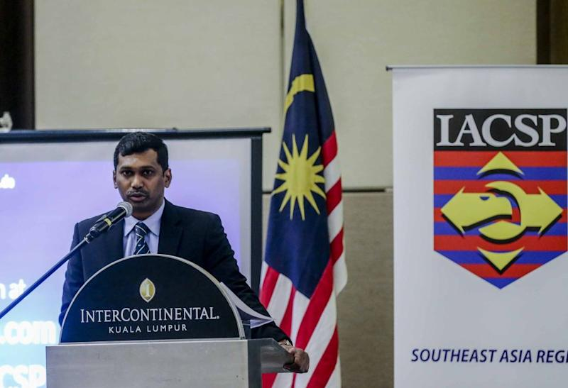 Immigration Department's Chief of Enforcement, Investigation and Prosecution Saravana Kumar speaks during the Asean Security Symposium in Kuala Lumpur August 28, 2018. ― Picture by Firdaus Latif