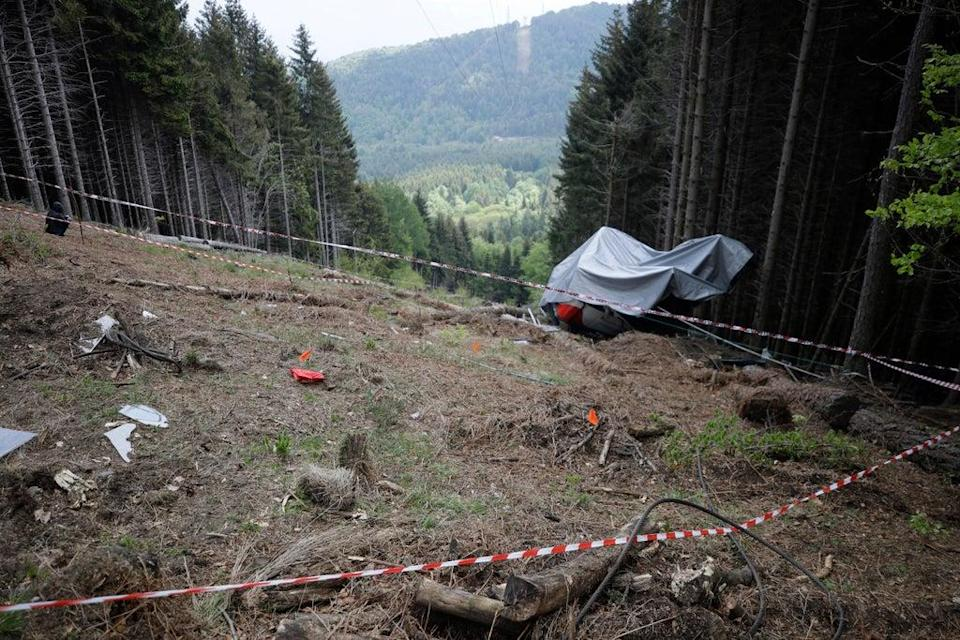 The wreckage of a cable car after it collapsed in May in the Piedmont region, northern Italy  (AP)