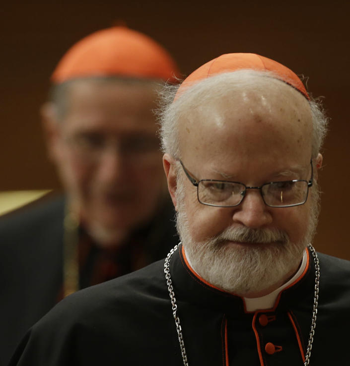 Cardinal Sean Patrick O'Malley, foreground, followed by cardinal Roger Mahoney arrives in St. Peter's Basilica to attend a vespers celebration at the Vatican, Wednesday, March 6, 2013. (AP Photo/Gregorio Borgia)