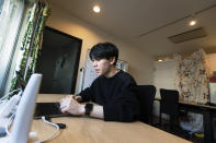 """Koki Ozora, a college student who started a nonprofit called """"Anata no Ibasho,"""" or """"A Place for You,"""" talks with a woman who'd like to help Ozora's organization, as he speaks in his office in Tokyo on Friday, Oct. 2, 2020. Suicides are on the rise among Japanese teens and that worries 21-year-old Ozora, who grew up depressed and lonely. His online Japanese-language chat service, run entirely by volunteers, offers a 24-hour text-messaging counseling for those seeking a sympathetic ear, promising to answer every request, within five seconds for urgent ones. (AP Photo/Hiro Komae)"""