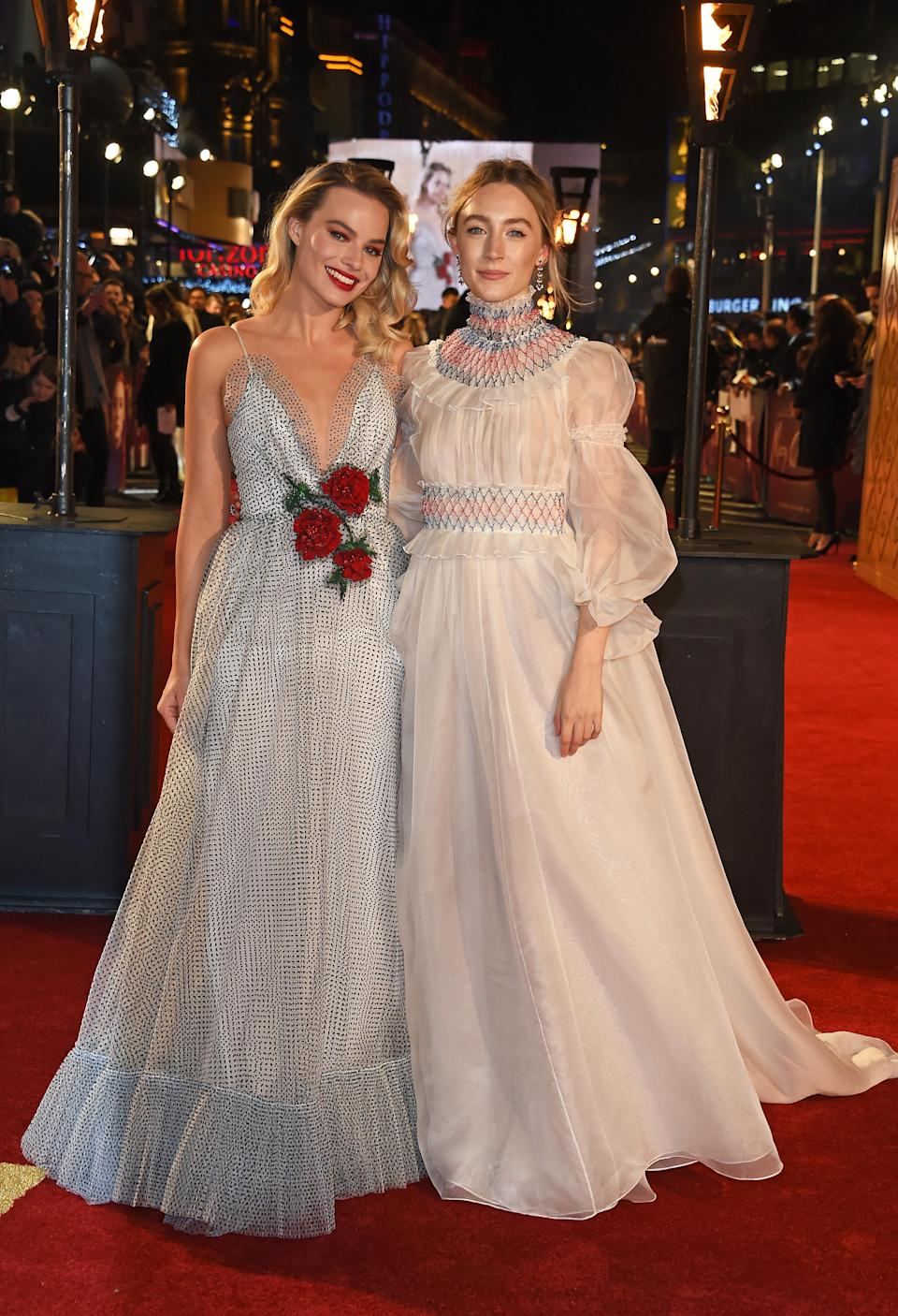 <p>The actors pose together at the London premiere of their upcoming film. Saoirse wore a gown by Carolina Herrera paaired with Giuseppe Zanotti shoes and Chopard jewels, while Margot wore a polka dot dress with a plunging neckline by Rodarte. <em>[Photo: Getty]</em> </p>