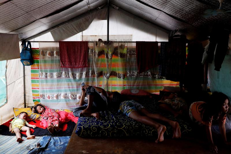 A family takes a nap in a tent at an evacuation camp for families displaced by the Marawi siege, in Marawi City, Lanao del Sur province, Philippines. (Photo: Eloisa Lopez/Reuters)