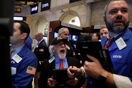 Traders works on the floor of the New York Stock Exchange (NYSE) in New York