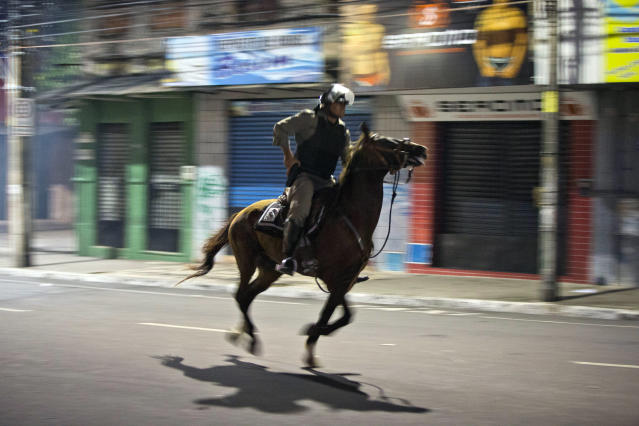 A Brazilian mounted police officer charges against protestors during a demonstration in downtown Fortaleza, Brazil, Friday, June 21, 2013. Demonstrations began as an outcry against a 10-cent hike in bus and subway fares in Brazil's largest cities, but have continued even after announcements that the increases would be rescinded. Protesters have expressed frustration with corruption and what they say are high taxes and poor public services. They've demanded everything from education reforms to free bus fares while denouncing the billions of public dollars spent on stadiums before the World Cup and the Olympics. (AP Photo/Victor R. Caivano)