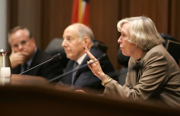 Appellate Judge Joan Dempsey Klein, right, a member of the California Commission on Judicial Appointments, speaks during questioning of a witness opposed to the nomination of Carol A. Corrigan to the Supreme Court of California during Corrigan's confirmation hearing in San Francisco, Wednesday Jan. 4, 2006. At left are commission members California Attorney General Bill Lockyer, left, and Supreme Court of California Chief Justice Ronald M. George, center. Appellate Judge Carol A. Corrigan, a former prosecutor, was sworn in Wednesday to the California Supreme Court. (AP Photo/Eric Risberg)