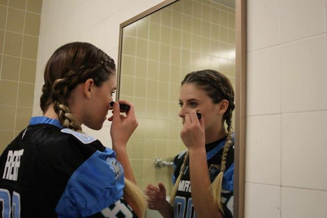 Defensive back Kaitlan Reiff puts on eyeblack before taking the field with the Nevada Storm. (Photo courtesy of Kaitlan Reiff)
