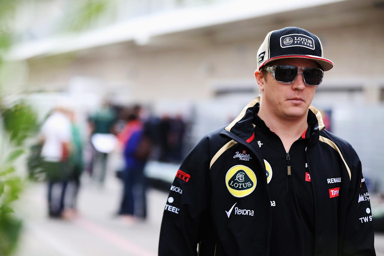 AUSTIN, TX - NOVEMBER 15:  Kimi Raikkonen of Finland and Lotus walks in the paddock during previews to the United States Formula One Grand Prix at the Circuit of the Americas on November 15, 2012 in Austin, United States.  (Photo by Mark Thompson/Getty Images)