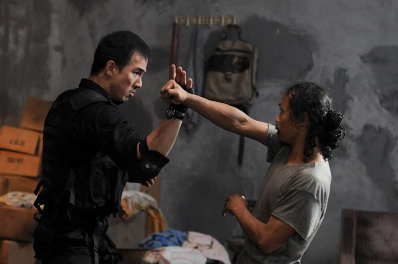 "In this film image released by Sony Pictures Classics, Joe Taslim as Jaka, left, and Yayan Ruhian as Mad Dog are shown in a scene from ""The Raid: Redemption."" (AP Photo/Sony Pictures Classics, Akhirwan Nurhaidir)"