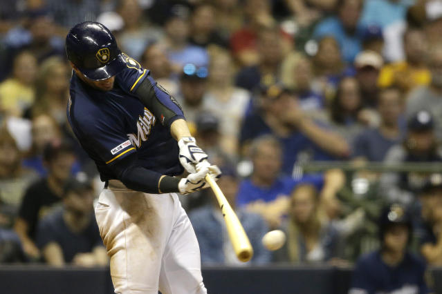 Milwaukee Brewers' Ryan Braun hits a one-run double during the sixth inning of a baseball game against the Pittsburgh Pirates, Saturday, Sept. 21, 2019, in Milwaukee. (AP Photo/Aaron Gash)