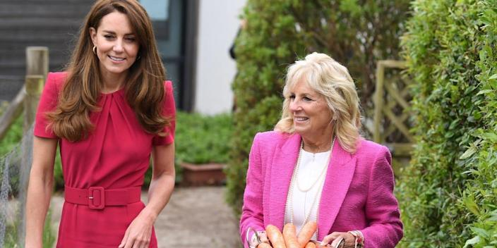 U.S. first lady Jill Biden holds a tray of carrots next to Britain's Catherine, Duchess of Cambridge, during a visit to Connor Downs Academy, in Hayle, Cornwall, Britain, June 11, 2021.