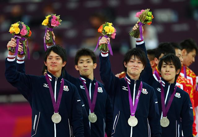 LONDON, ENGLAND - JULY 30: Silver medalists Kohei Uchimura, Yusuke Tanaka, Koji Yamamuro, Kazuhito Tanaka and Ryohei Kato of Japan celebrate during the medal ceremony in the Artistic Gymnastics Men's Team final on Day 3 of the London 2012 Olympic Games at North Greenwich Arena on July 30, 2012 in London, England. (Photo by Michael Steele/Getty Images)