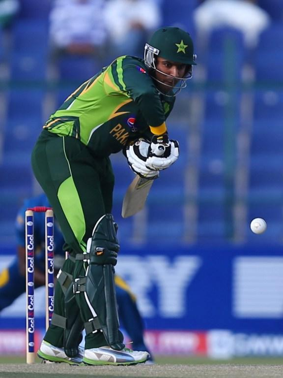 Pakistani batsman Sharjeel Khan plays a shot during the fifth and final One Day International cricket match between Pakistan and Sri Lanka in Abu Dhabi on December 27, 2013.       AFP PHOTO/MARWAN NAAMANI