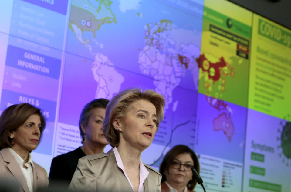 FILE - In this Monday, March 2, 2020 file photo, European Commission President Ursula von der Leyen, center, speaks during a media conference regarding COVID-19 at the Emergency Response Coordination Center in Brussels. A last-minute trade deal with the United Kingdom coupled with the rollout of COVID-19 vaccines in the final days of the year produced a sense of success for the 27-nation bloc and brought glimmers of hope to the EU's 450 million residents. (AP Photo/Virginia Mayo, File)
