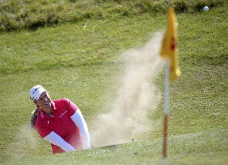 Lincicome of the U.S plays a bunker shot at the 11th hole during the women's British Open golf tournament at Royal Birkdale Golf Club