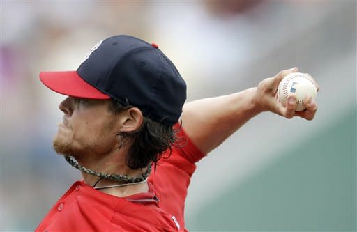 Boston Red Sox starting pitcher Clay Buchholz throws a pitch in the first inning of a spring training exhibition baseball game against the Toronto Blue Jays, Tuesday, March 12, 2013, in Fort Myers, Fla. (AP Photo/David Goldman)