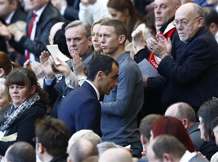 Everton manager Roberto Martinez is applauded after speaking during a memorial service to mark the 25th anniversary of the Hillsborough disaster at Anfield in Liverpool, northern England April 15, 2014. REUTERS/Darren Staples