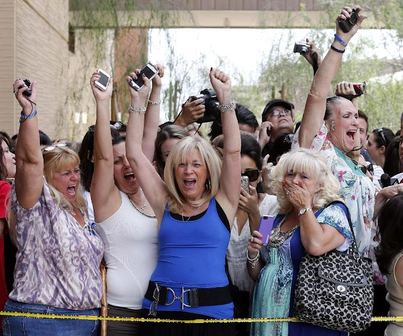 Spectators react to a guilty verdict in the murder trial of Jodi Arias, Wednesday, May 8, 2013 in Phoenix. Arias was convicted of first-degree murder Wednesday in the 2009 killing of her one-time boyfriend Travis Alexander after a four-month trial.  (AP Photo/Matt York)