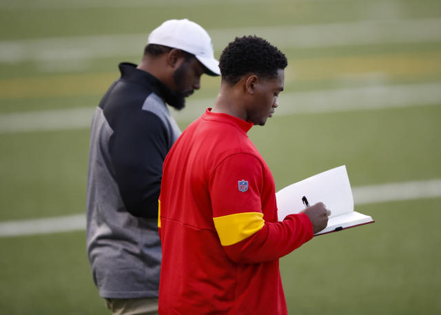 Representatives from the New York Jets and Kansas City Chiefs watch free agent quarterback Colin Kaepernick participate in an NFL football workout, Saturday, Nov. 16, 2019, in Riverdale, Ga. (AP Photo/Todd Kirkland)