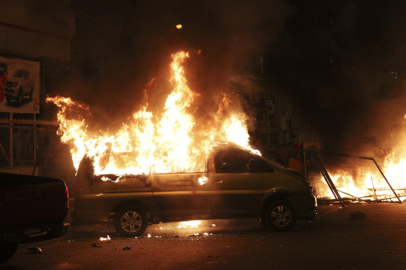 A van set on fire by protesters burns in Santiago, Chile, Sunday, Oct. 20, 2019. Protests in the country have spilled over into a new day, even after President Sebastian Pinera cancelled the subway fare hike that prompted massive and violent demonstrations. (Photo: Esteban Felix/AP)