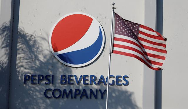 The Pepsi logo next to a U.S. flag is pictured in Irwindale, California, U.S., July 11, 2017. REUTERS/Mario Anzuoni