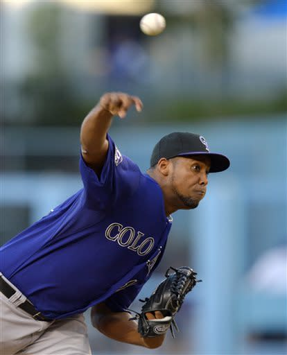 Colorado Rockies starting pitcher Juan Nicasio throws to the plate during the first inning of their baseball game against the Los Angeles Dodgers, Friday, July 12, 2013, in Los Angeles. (AP Photo/Mark J. Terrill)