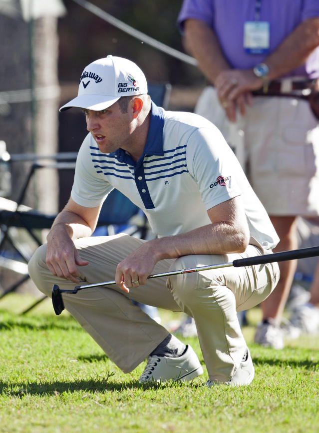Chris Kirk lines up his putt on the ninth green during the first round of the Sony Open golf tournament on Thursday, Jan. 9, 2014, in Honolulu. (AP Photo/Marco Garcia)