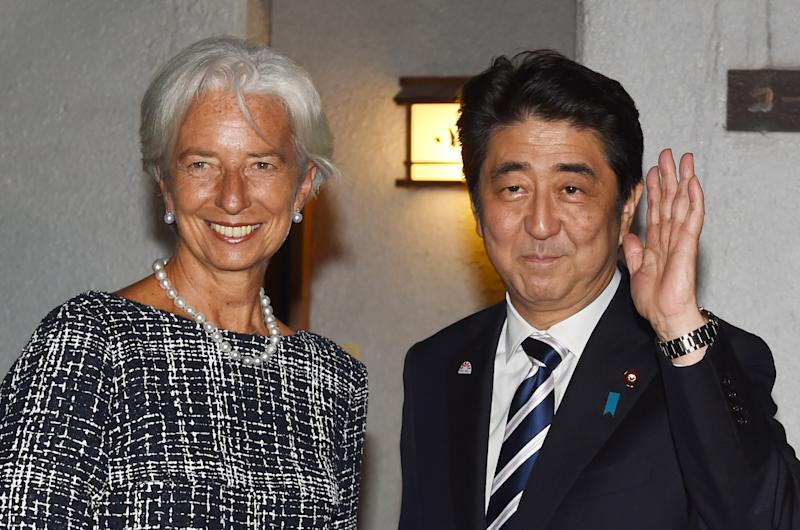 Japan Prime Minister Shinzo Abe greets IMF head Christine Lagarde in Tokyo, where she is due to give a keynote speech on women in the workforce, September 11, 2014 (AFP Photo/Kazuhiro Nogi)